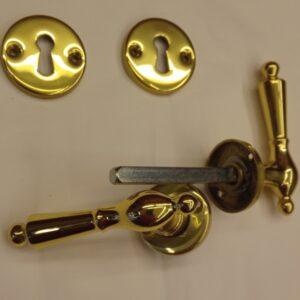 coppia di maniglie da porta in ottone